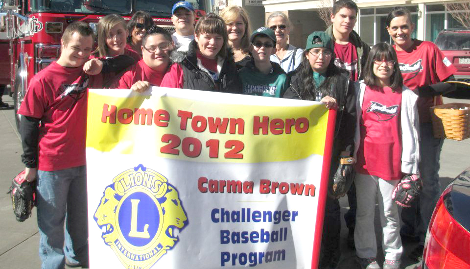 Home Loan Insurance's agent Carma Brown received the Grand Junction Lions Club