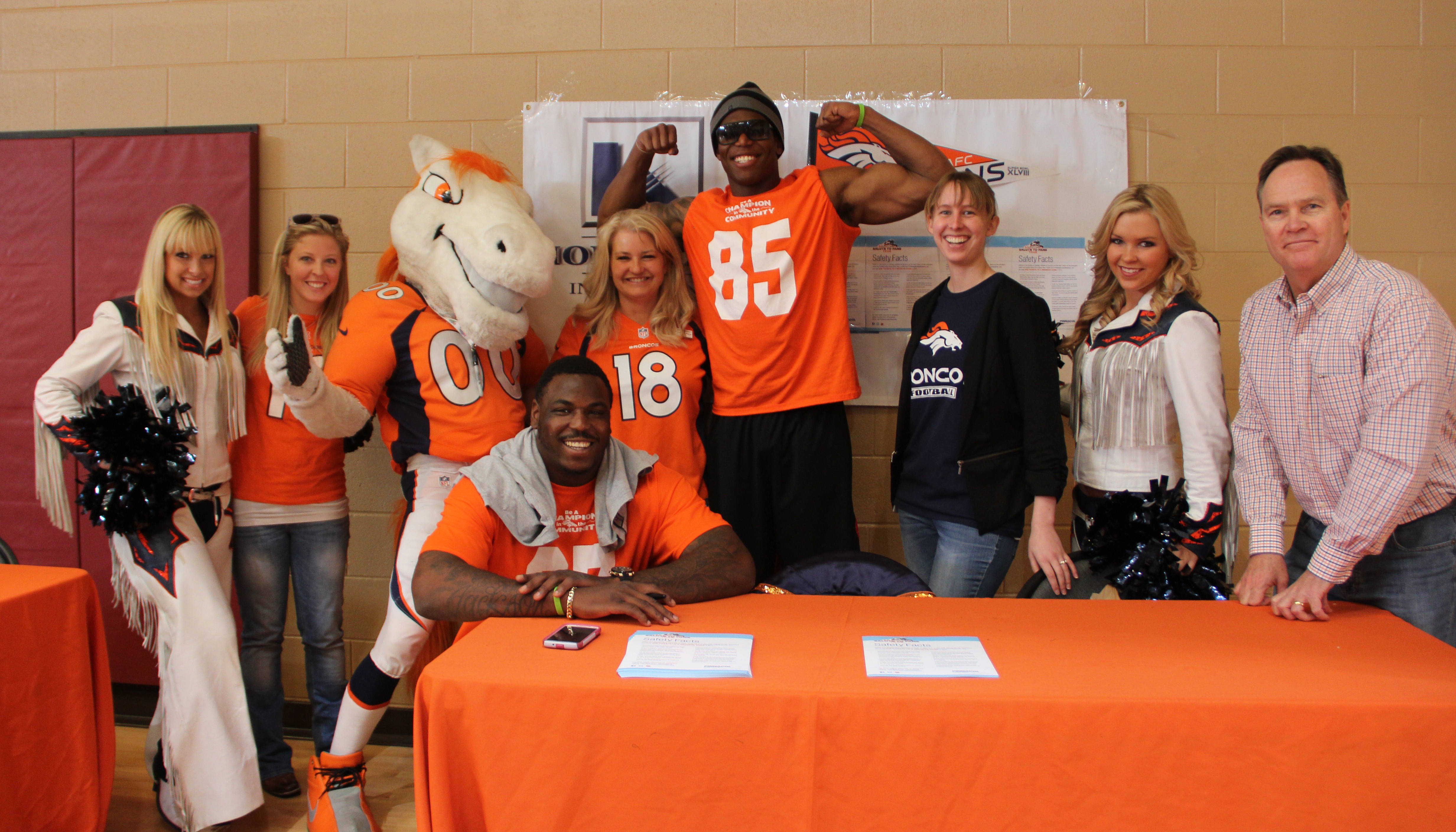 Home Loan Insurance employees help raise safety awareness with Pinnacol Assurance and the Denver Broncos!